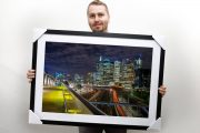 Me holding a 20×30″ print with 60mm matt and timber frame